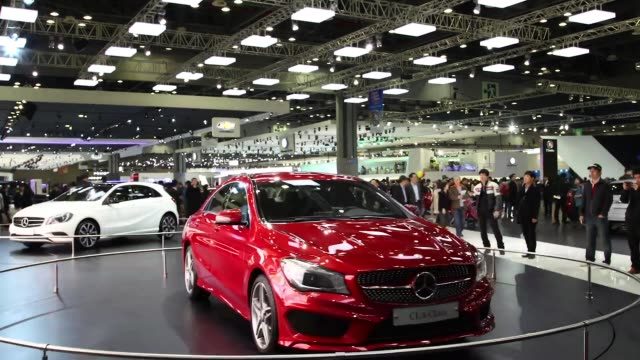 timelapse sequence showing mercedesbenz claclass car rotating on display stand on the press day of the 2013 seoul motor show in goyang the seoul... - goyang stock videos and b-roll footage