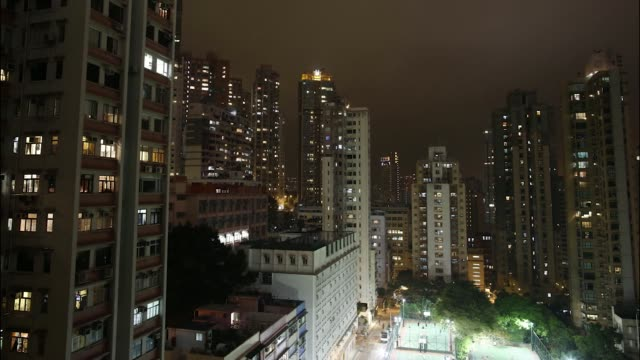 vídeos y material grabado en eventos de stock de timelapse sequence shows apartment blocks standing at night in the sheung wan area of hong kong china on friday feb 28 2014 hong kong skyline... - sheung wan
