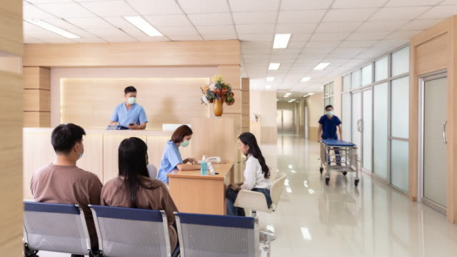 4k uhd time-lapse series dolly zoom in and out : people crowded of doctor nurse and patient in hospital corridor and emergency zone. hospital health care concept. - waiting room stock videos & royalty-free footage