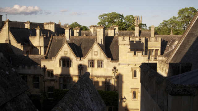 timelapse shadows lengthen as sun sets over roof tops, oxford, uk - oxford england stock videos and b-roll footage