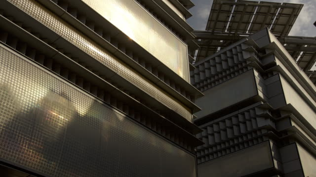 Timelapse shadows shift across face of building, Masdar, Abu Dhabi