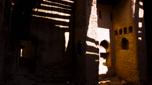 timelapse shadows shift over ancient building, rustaq, oman - ancient stock videos & royalty-free footage