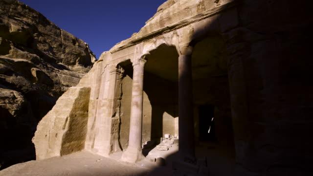 Timelapse shadows shift over ancient rock-cut ruins, Petra, Jordan