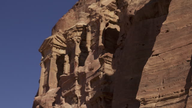 timelapse shadows shift over ancient rock-cut tombs, petra, jordan - ancient stock videos & royalty-free footage