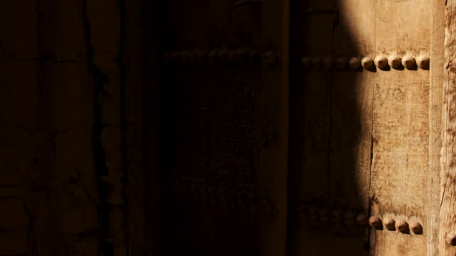 timelapse shadows shift over carved wooden door, rustaq, oman - oman stock videos & royalty-free footage