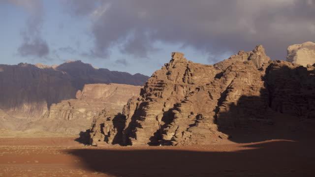 Timelapse shadows shift over eroded desert rock, Wadi Rum, Jordan