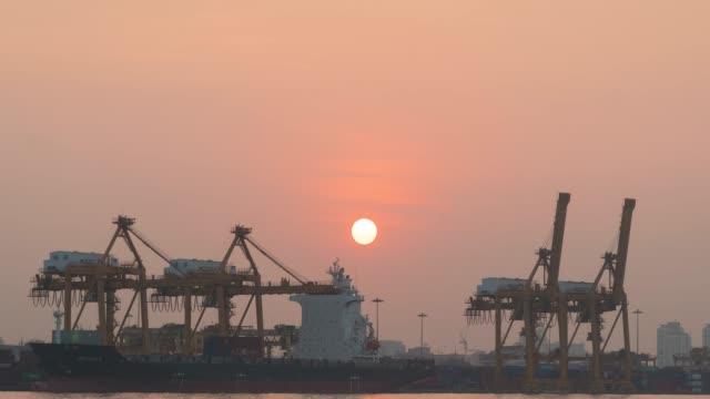 4K Timelapse: Shipping cargo in morning.