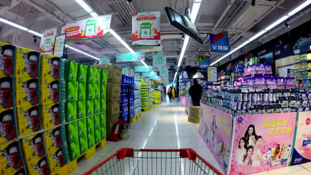 timelapse shopping cart in supermarket - market retail space stock videos & royalty-free footage