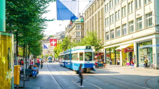 timelapse shopping street at bahnhofstrasse in zurich, switzerland - cable car stock videos and b-roll footage