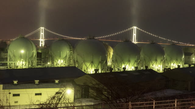 Time-lapse shot; A plant with its spherical oil tanks in Muroran's industrial zone, Hokkaido, Japan.