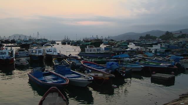 timelapse shot boats in sea hong kong kwangtung china - förtöjd bildbanksvideor och videomaterial från bakom kulisserna