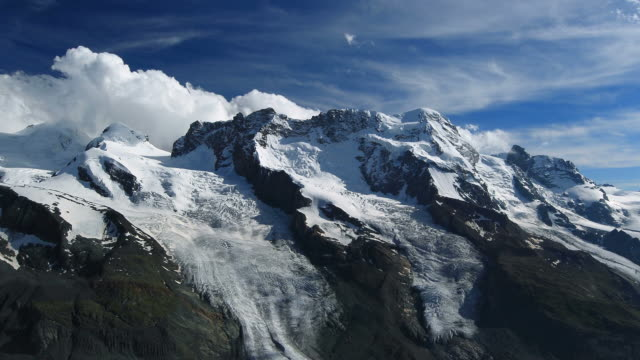 timelapse shot from breithorn in switzerland - pennines stock videos & royalty-free footage