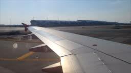 Timelapse: shot of a view through a window of an aircraft landing at Suvarnabhumi Airport,Bangkok,Thailand