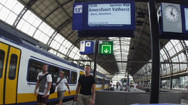 """amsterdam, netherlands - circa 2013: time-lapse shot of activities at a depot on 2013 in amsterdam, netherlands"" - station stock videos & royalty-free footage"