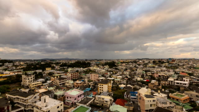 timelapse shot of cityscape and moving sky. - okinawa prefecture stock videos & royalty-free footage