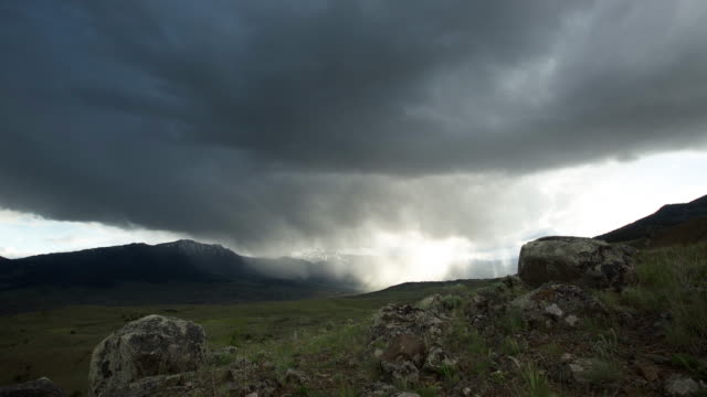 timelapse shot of clouds moving over the landscape - yellowstone nationalpark stock-videos und b-roll-filmmaterial
