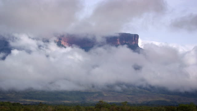 Timelapse shot of clouds rolling over a Tepui mountain, Venezuela.