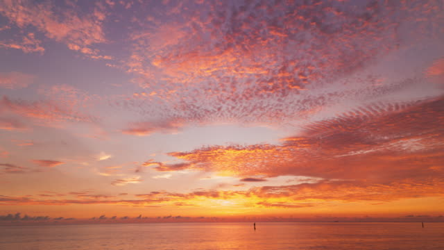 timelapse shot of cloudscape in sunset.japan, - okinawa stock videos and b-roll footage