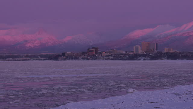 time-lapse shot of downtown anchorage and bootleggers cove viewed from point mackenzie at sunset - anchorage alaska stock videos & royalty-free footage