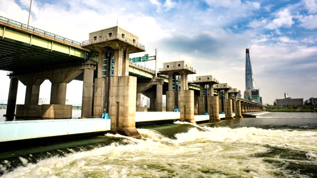 time-lapse shot of ecological barrage under jamsildaegyo bridge at hangang river (natural landmark and the major river in seoul) - natural landmark stock videos & royalty-free footage