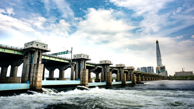 time-lapse shot of ecological barrage under jamsildaegyo bridge on hangang river (natural landmark and the major river in seoul) - natural landmark stock videos & royalty-free footage