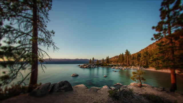 timelapse shot of sand harbor, lake tahoe in nevada. - day to night time lapse stock videos & royalty-free footage