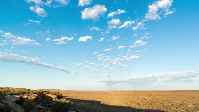 timelapse shot of slow moving scattered clouds over a karoo landscape - karoo bildbanksvideor och videomaterial från bakom kulisserna