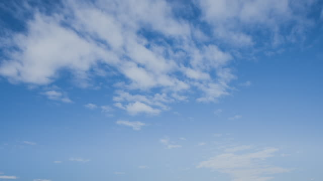 timelapse shot of wispy clouds in a blue sky - generic location stock videos & royalty-free footage