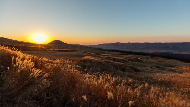time-lapse shot: sunset in the aso caldera, kumamoto, japan. - caldera stock videos and b-roll footage