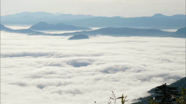 time-lapse shot; the sea of clouds over lake kussharo - stratus stock videos & royalty-free footage