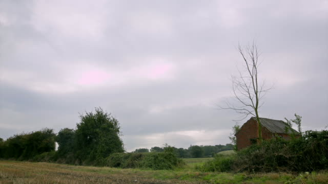 timelapse shots of field next to barn - run down stock videos & royalty-free footage