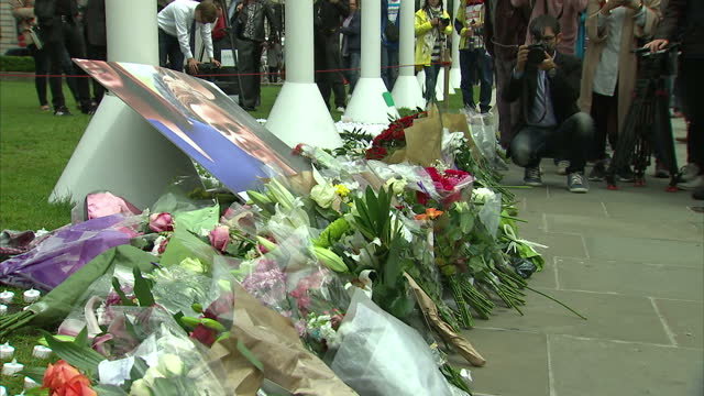 timelapse shots of passers by stopping to look at tribute messages for jo cox mp who was killed in her constituency on 16th july tribute flowers have... - jo cox politician stock videos and b-roll footage