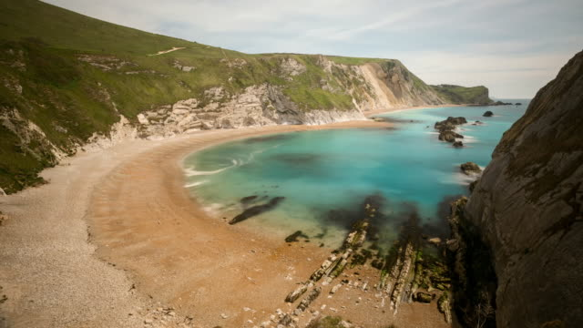 timelapse shots of tide on picturesque beaches, uk - tide stock videos & royalty-free footage
