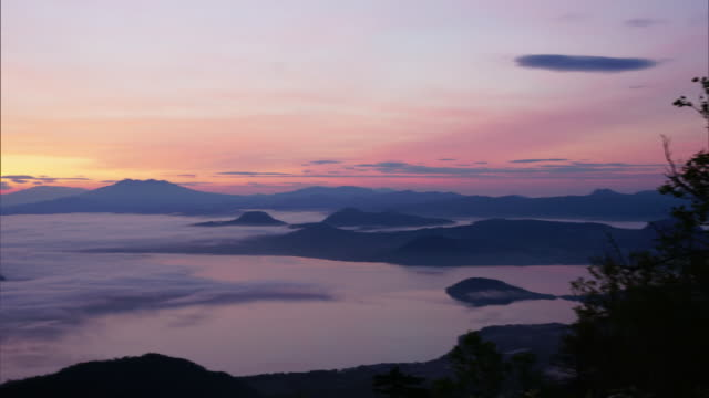 time-lapse shot;the sea of clouds over lake kussharo - light natural phenomenon stock videos & royalty-free footage