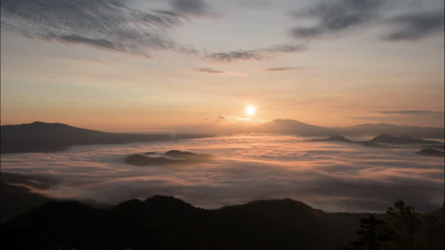 time-lapse shot:the sea of clouds over lake kussharo - light natural phenomenon stock videos & royalty-free footage