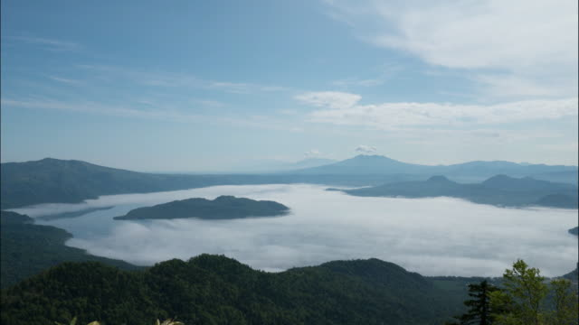 time-lapse shot;the sea of clouds over lake kussharo - caldera stock videos and b-roll footage