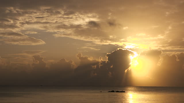 time-lapse shows the sunrise over the indian ocean on june 13, 2020 in dar es salaam, tanzania. - digital composite stock videos & royalty-free footage