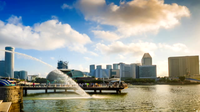 hd time-lapse: singapore cityscape at dusk - marina bay sands stock videos and b-roll footage