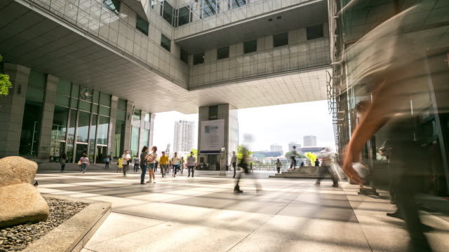4K Time-lapse: Singapore Cityscape Office Background with Pedestrian