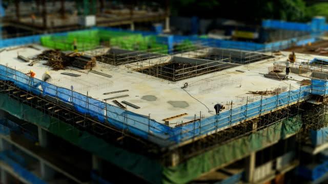 vídeos de stock, filmes e b-roll de lapso de tempo de construção de site cingapura - armação de janela
