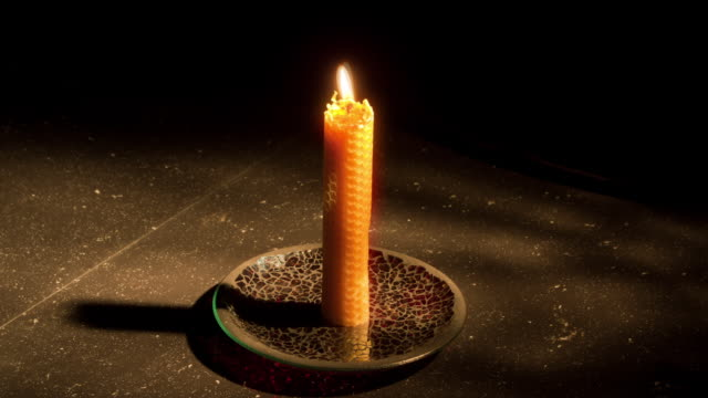 Time-Lapse Single candle burning down with shadows