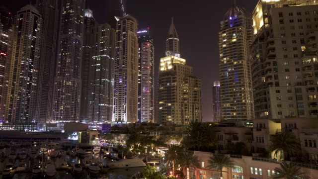 Timelapse skyscrapers and people on Marina walk, Dubai Marina, Dubai