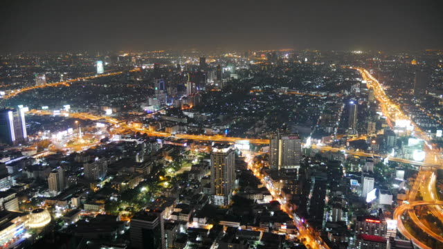 timelapse: Skyscrapers and traffic night lights over the city. Baiyoke bangkok view