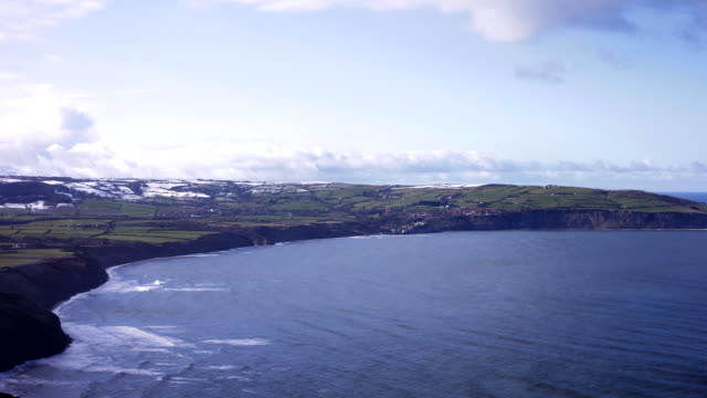 timelapse, snow covers the hills on the north york moors above robin hoods bay - north york stock videos & royalty-free footage