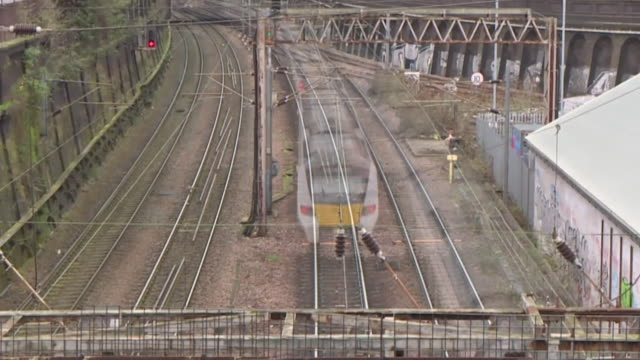 timelapse speeded up footage of trains moving along rail tracks - blurred motion stock videos & royalty-free footage