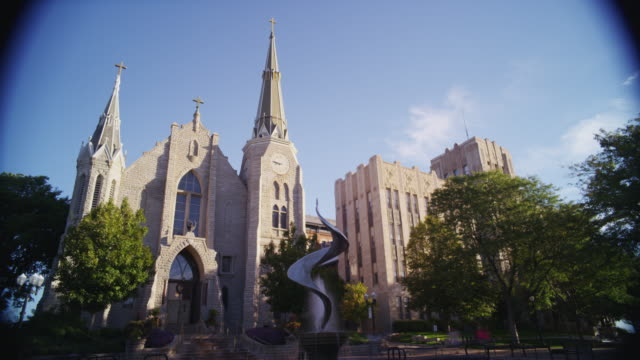 Time-lapse. St. Johns Cathedral church - blue sky and clouds pass.