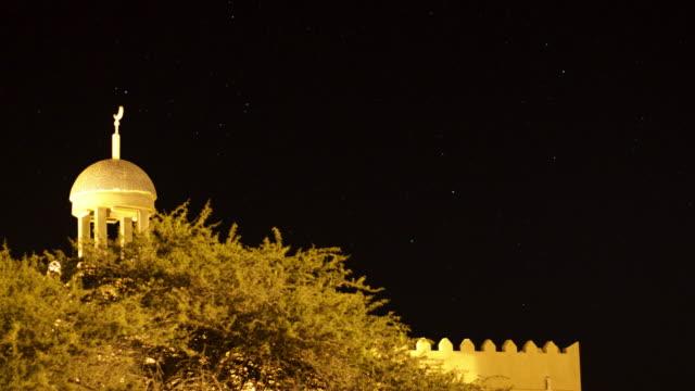 Timelapse stars drift over mosque, Dhofar, Oman