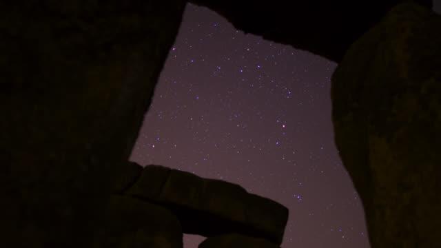 timelapse stars track over prehistoric stonehenge monument, wiltshire, uk - stonehenge stock videos and b-roll footage