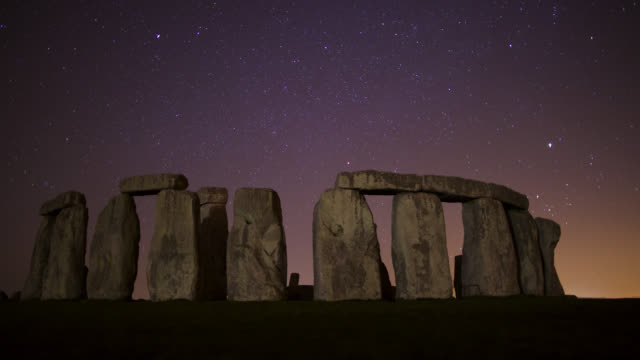 timelapse stars track over prehistoric stonehenge monument, wiltshire, uk - prehistoric era stock videos & royalty-free footage