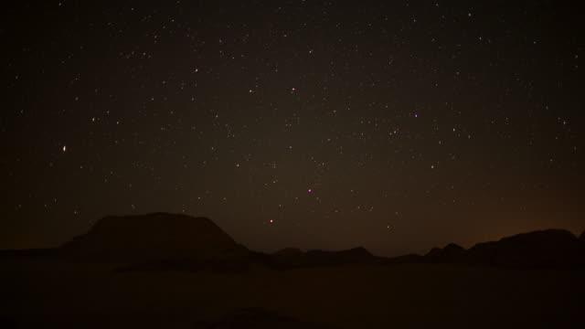 timelapse stars track over rocks and petroglyphs, wadi rum, jordan - antike kultur stock-videos und b-roll-filmmaterial